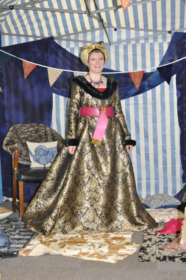 My late fifteenth-century Burgundian gown, with red kirtle and reticulated headdress.